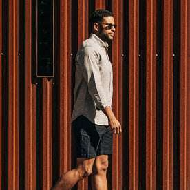 our fit model wearing The Trail Short in Navy Slub Sateen—walking right