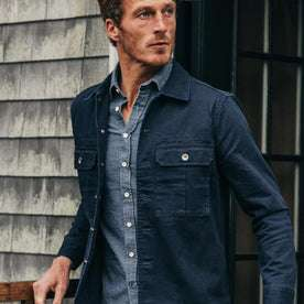 fit model wearing The HBT Jacket in Washed Navy, looking right