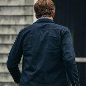 fit model wearing The HBT Jacket in Washed Navy, back shot