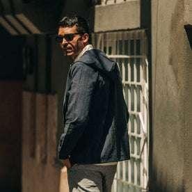 fit model wearing The Riptide Jacket in Indigo Slub, looking back