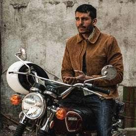 fit model wearing The Wyatt Jacket in Cognac Suede, on motorcycle