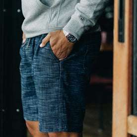 our fit model wearing The Après Short in Indigo Slub—wearing a hoodie early in the morning, cropped shot of pocket
