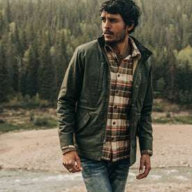 our fit model wearing The Harris Jacket in Forest Dry Wax—looking left
