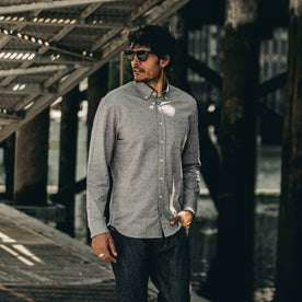 our fit model wearing The Jack in Charcoal Fleck—looking left