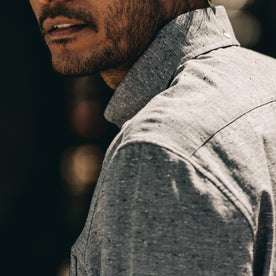 our fit model wearing The Jack in Charcoal Fleck—cropped shot of shoulder