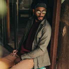 fit model wearing The BDU Shirt Jacket in Rain Drop Camo, sitting, sunglasses on