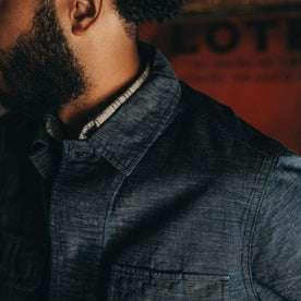 fit model wearing The BDU Shirt Jacket in Indigo Slub, chest detail