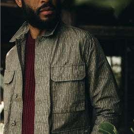 fit model wearing The BDU Shirt Jacket in Rain Drop Camo, chest detail