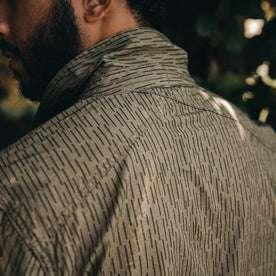 fit model wearing The BDU Shirt Jacket in Rain Drop Camo, back detail