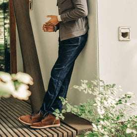 our fit model wearing The Camp Pant in Indigo Corduroy against a wall