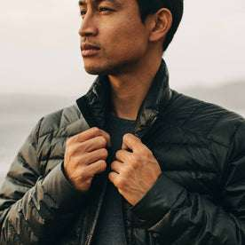 our fit model wearing The Taylor Stitch x Mission Workshop Farallon Jacket in Black—cropped shot of chest