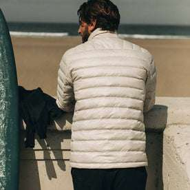 our fit model wearing The Taylor Stitch x Mission Workshop Farallon Jacket in fog—back shot