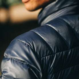 out fit model wearing The Taylor Stitch x Mission Workshop Farallon Jacket in Midnight Blue—shoulder detail shot