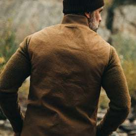 our fit model wearing The Reversible Able Vest in Arid Camo—back shot