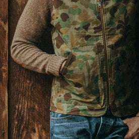our fit model wearing The Reversible Able Vest in Arid Camo—reversed camo side close up