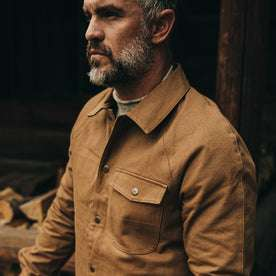 fit model wearing The Reversible Lombardi Jacket in Arid Camo—looking left