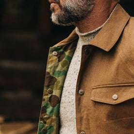 fit model wearing The Reversible Lombardi Jacket in Arid Camo—camo showing underneath