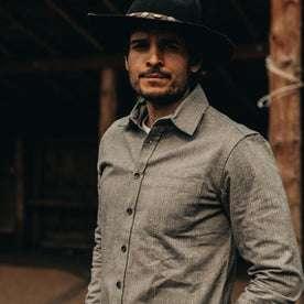 fit model wearing The Mechanic Shirt in Slate Herringbone, hat on