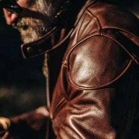 our fit model wearing The Band Collar Moto Jacket—shoulder shot
