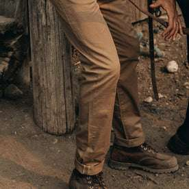 fit model wearing The Slim All Day Pant in Rustic Oak Organic Selvage, thigh down
