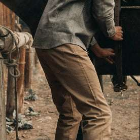 fit model wearing The Slim All Day Pant in Rustic Oak Organic Selvage, back/side shot