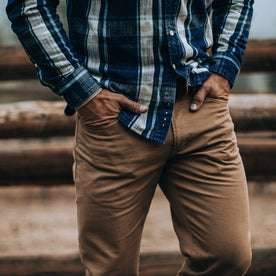 fit model wearing The Democratic All Day Pant in Rustic Oak Organic Selvage, hands in pockets
