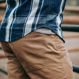 fit model wearing The Democratic All Day Pant in Rustic Oak Organic Selvage, back pocket