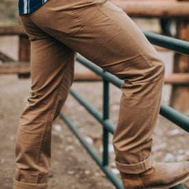 fit model wearing The Democratic All Day Pant in Rustic Oak Organic Selvage, side