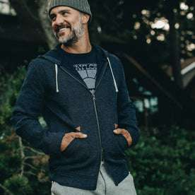 our fit model rocking The Après Hoodie in Indigo Waffle—outside, smiling