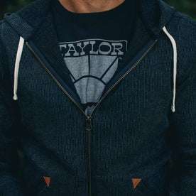 our fit model rocking The Après Hoodie in Indigo Waffle—cropped shot of chest