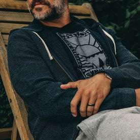 our fit model rocking The Après Hoodie in Indigo Waffle—cropped shot of chest sitting down