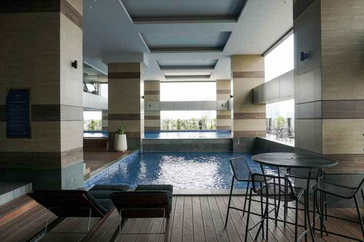 SWIMMING_POOL Homey and Modern 2BR Apartment at Maqna Residence By Travelio
