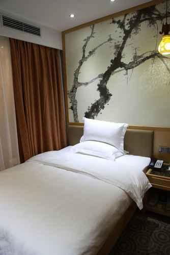 BEDROOM โรงแรมซิงเหอ บิสสิเนส (เรลเวย์สเตชั่นแอนด์หยีเซี่ยวพาร์ค)