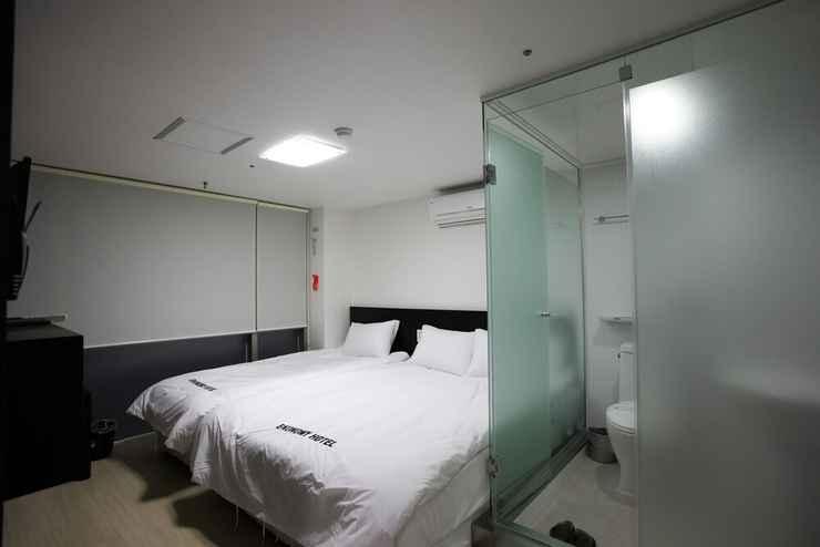 BEDROOM โรงแรมอีโคโนมี เมียงดง พรีเมียร์