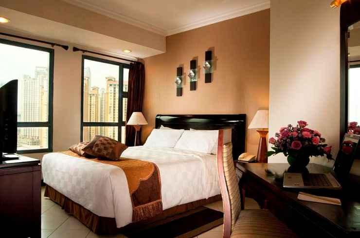 BEDROOM Grand Tropic Suites Hotel