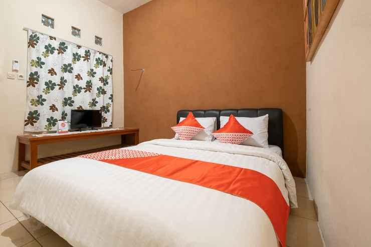 BEDROOM OYO 2168 Mettaloka Guesthouse