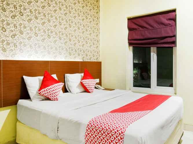 BEDROOM Capital O 454 Raising Hotel