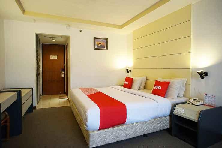BEDROOM Capital O 1963 Hotel The New Benakutai