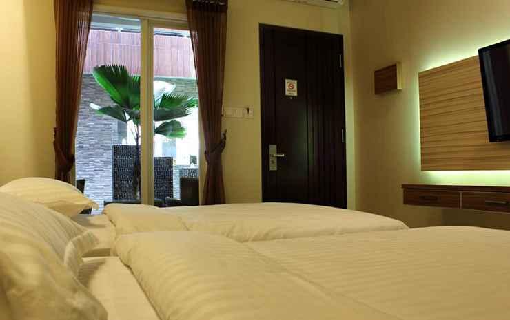 de'Corner Suite Guest House Malang - Deluxe Gardenview Twin Bed