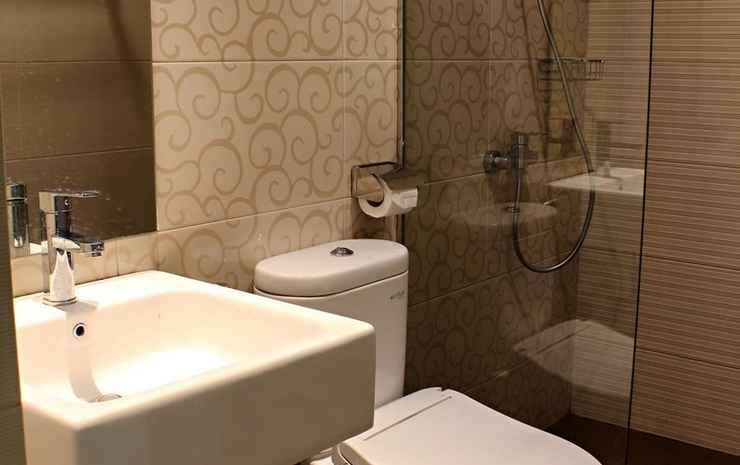 de'Corner Suite Guest House Malang - Deluxe Gardenview Double bed
