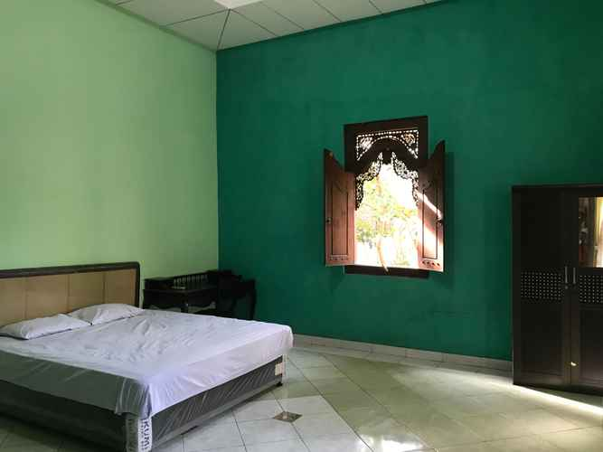 BEDROOM Puri Saripan Bed & Breakfast