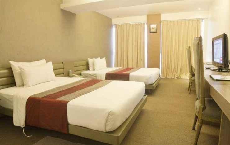 BEDROOM The E-Hotel Makati