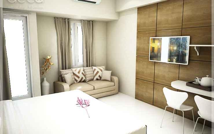 Studio Room at Cosmy Orchard Apartment Surabaya - Executive Room with Balcony