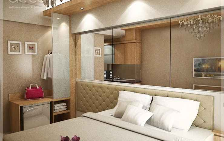 Studio Room at Cosmy Orchard Apartment Surabaya - Deluxe Room with Balcony