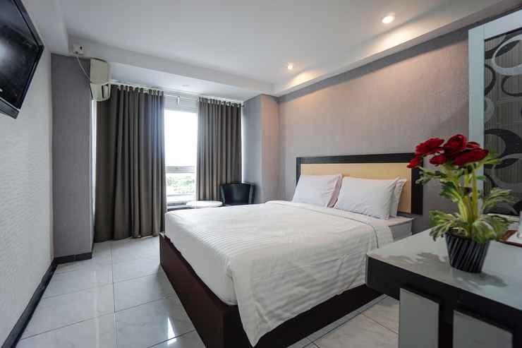 BEDROOM Capital O 3433 Hotel Plaza