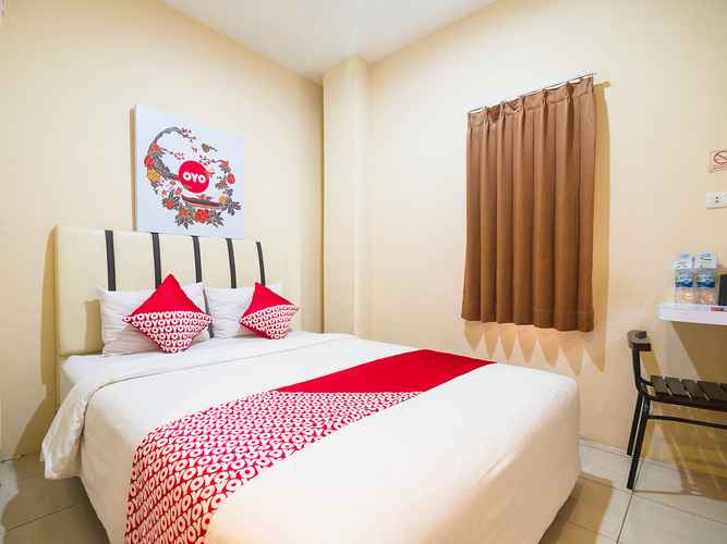 BEDROOM OYO 1484 Sentosa Guest House