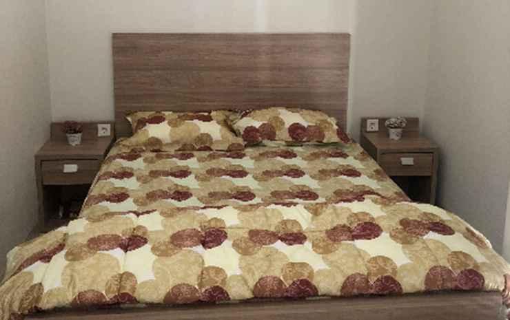 Liza Regentown Gold Tangerang Selatan - Deluxe Double Bed