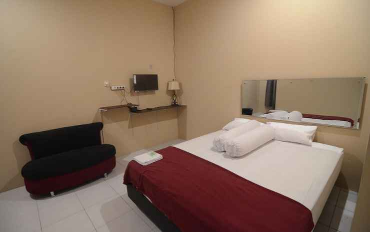 Clean Room at Myura Guest House Banyumas - Deluxe AC