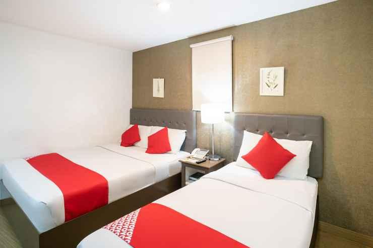 BEDROOM OYO 106 24H City Hotel