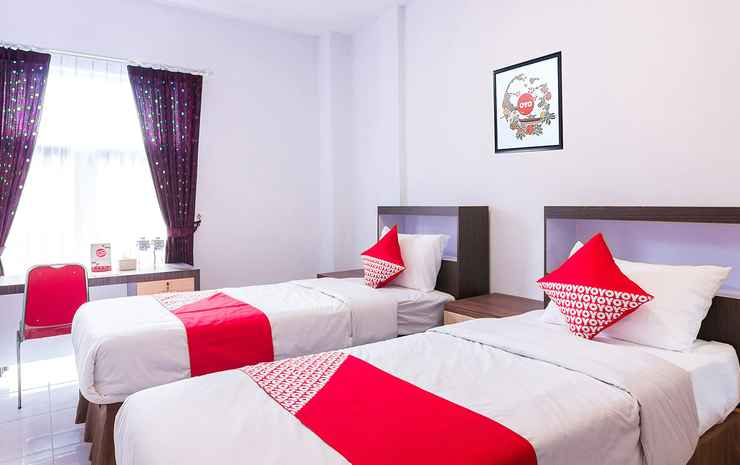 OYO 1118 Artomoro Family Guesthouse Yogyakarta - Deluxe Twin